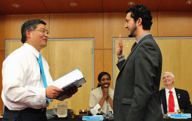 JAMES G. HILL, PCC - PCC President Mark Mitsui swears in new board member Mohamed Alyajouri of Beaverton.