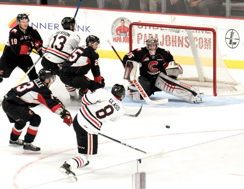 COURTESY: CHAD BAKER/PORTLAND WINTERHAWKS - Portland Winterhawks forward Cody Glass fires a shot at the Prince George net.