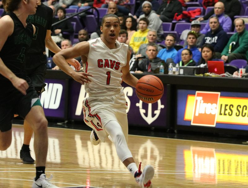 REVIEW/NEWS PHOTO: JIM BESEDA - Clackamas' Elijah Gonzales scored 31 points in Wednesday's OSAA Class 6A boys' basketball quarterfinal win over West Salem at the Chiles Center.
