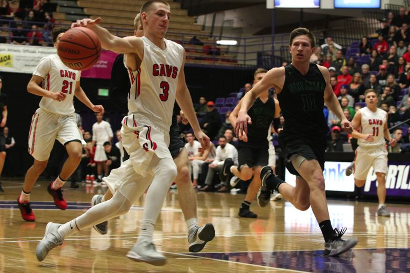 PMG PHOTO: JIM BESEDA - Clackamas' Hunter Coyle tries to corral a loose ball during his team's 68-52 win over West Salem in the quarterfinals of the Class 6A boys state basketball tournament at the Chiles Center on Wednesday.
