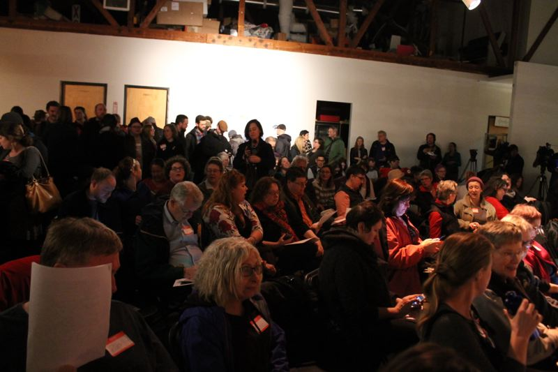 TRIBUNE PHOTO: LYNDSEY HEWITT - Disjecta was packed with more than 200 people to hear organizers discuss the tiny-home project.
