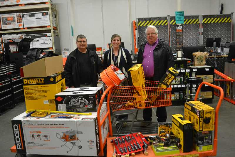 COURTESY PHOTO: SEDCOR - (From left) Withers Lumber vice president of sales John Gooley, Kennedy High School teacher Korrie Shull and SEDCOR retention and expansion manager Nick Harville selected construction equipment to donate to Shull's classroom.
