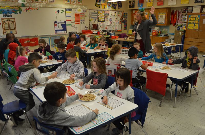 SPOTLIGHT PHOTO: NICOLE THILL - Kindergarteners in Keely Nudo's class completed a variety of activities centered around the number 100 on Tuesday, March 7, the 100th day of school.