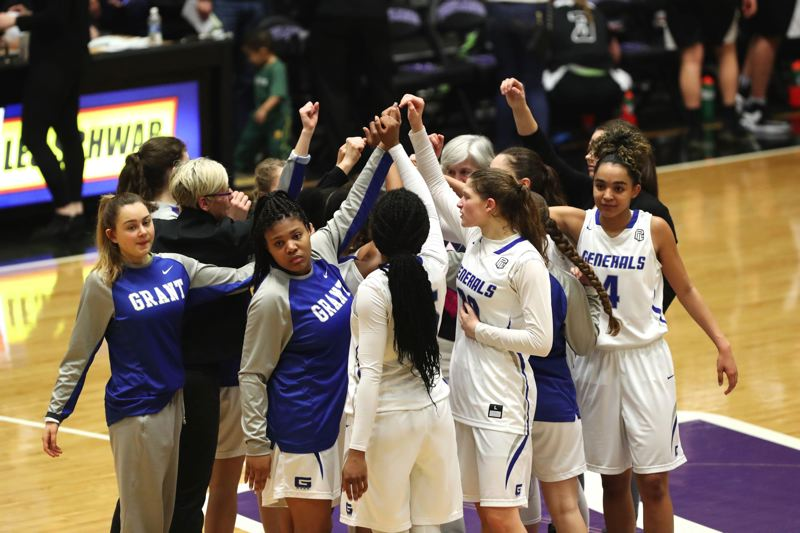 TRIBUNE PHOTO: JAIME VALDEZ - The Grant High Generals celebrate after defeating South Medford 56-45 Thursday afternoon at Chiles Center and advancing to the Class 6A semifinals.