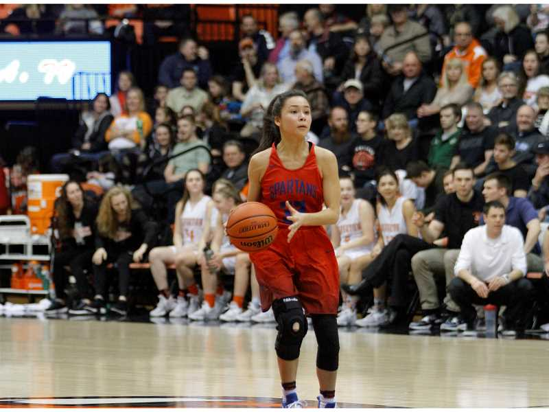 HILLSBORO TRIBUNE PHOTO: WADE EVANSON - The Spartans' Katherine Salas dribbles the ball up the court during Hilhi's state tournament game versus Silverton March 8.