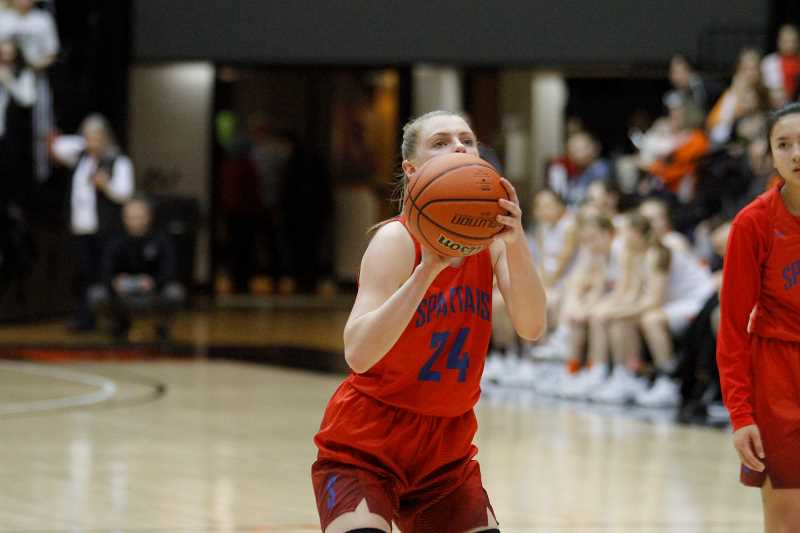 HILLSBORO TRIBUNE PHOTO: WADE EVANSON - Hilhi's Kendra Wilson lines-up a free throw during the Spartans' game versus Silverton in the state tournament.