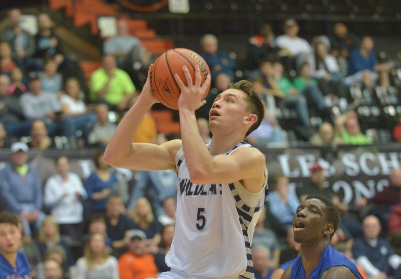 SPOKESMAN PHOTO: COREY BUCHANAN - Wilsonville senior wing Harrison Steiger led the Wildcats with 19 points against La Salle.