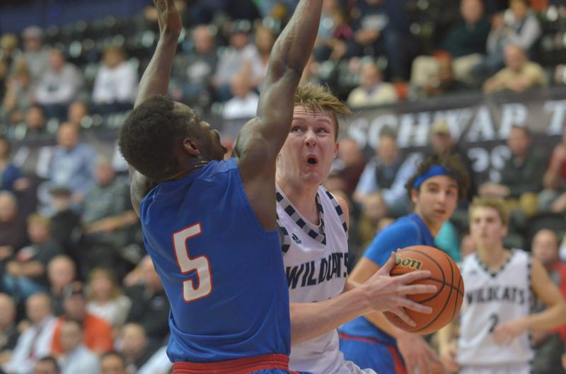 SPOKESMAN PHOTO: COREY BUCHANAN - Wilsonville senior wing Zach Reichle scored 14 points against the Falcons.