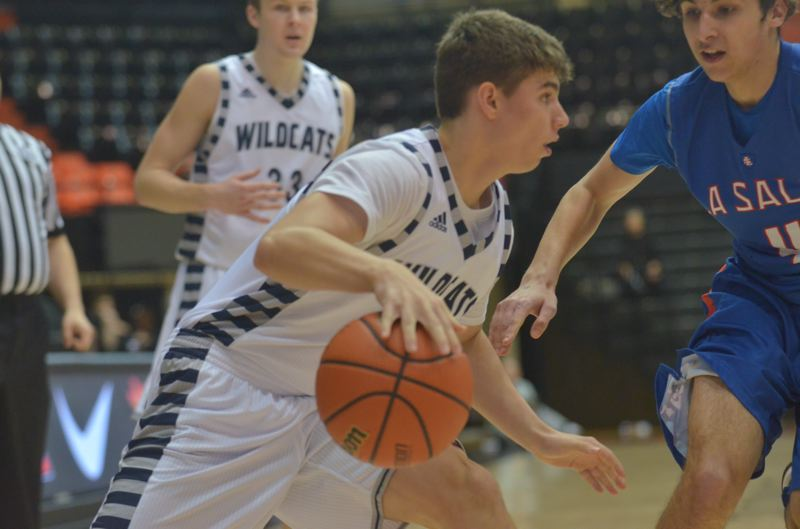 SPOKESMAN PHOTO: COREY BUCHANAN - Wilsonville sophomore guard Jack Roche ran the clock out with the Wildcats up by two and under five seconds left.