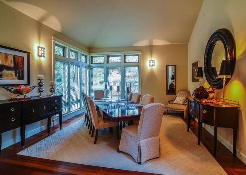 OUTLOOK PHOTO: JOSH KULLA - The formal dining room is an elegant space tucked away near the entrance to the home.