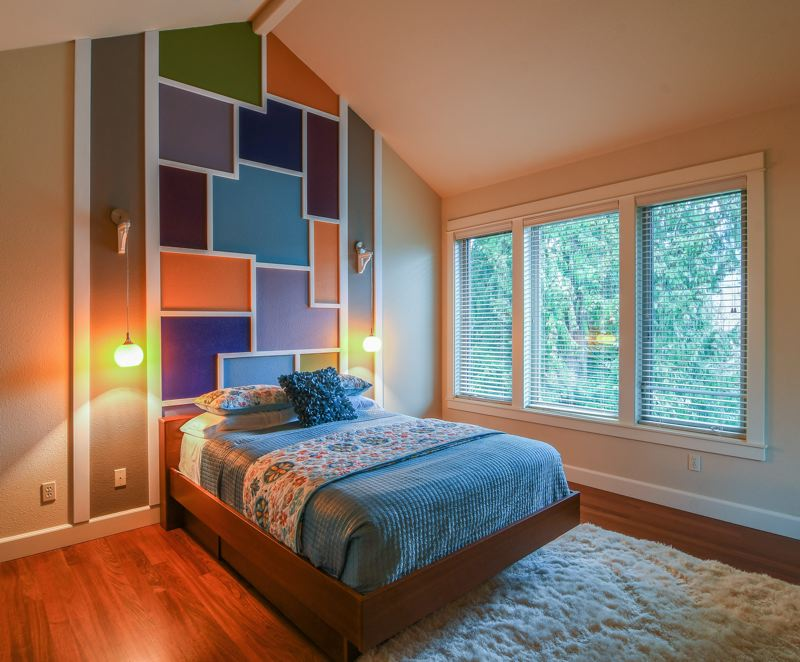 OUTLOOK PHOTO: JOSH KULLA - This colorful bedroom shows off the vaulted ceilings that dominate the house.