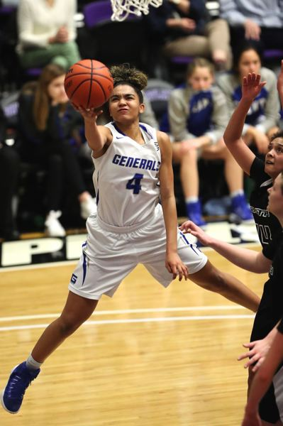 TRIBUNE PHOTO: JAIME VALDEZ - Grant High's Daryn Hickok twists around and shoots over South Medford in the quarterfinals of the 6A girls basketball tournament Thursday at Chiles Center.