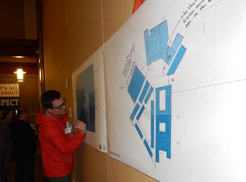 SHERWOOD GAZETTE PHOTO: BARBARA SHERMAN - Many of the dozens of community members who attended the March 9 community input session for the new  high school wrote their suggestions on the architects' drawings.