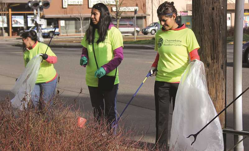 INDEPENDENT FILE PHOTO - Volunteers pick up trash in downtown Woodburn for the 2014 Woodburn Proud Clean Up Day.