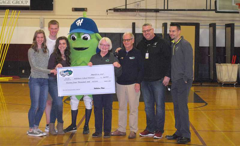 SUBMITTED PHOTO - The Hillsboro Hops donated $24,000 to Hillsboro Schools on Friday, to help pay for extra-curricular activities across the district.