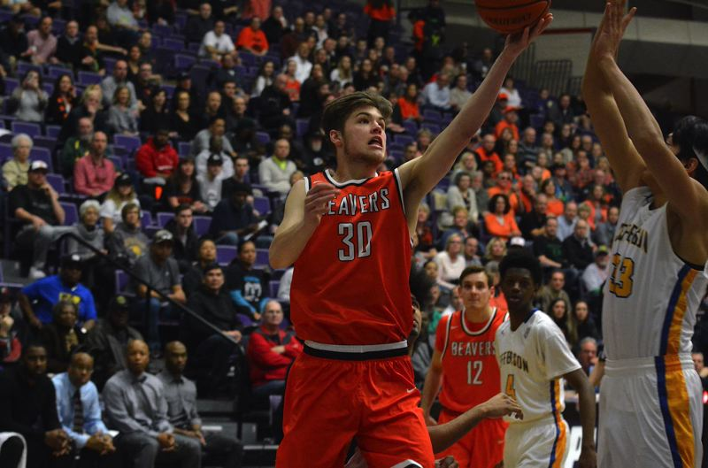 TIMES PHOTO: MATT SINGLEDECKER - Beaverton junior Jake Estep skies to the rim for a lefty layup against Jefferson in the Class 6A semis.