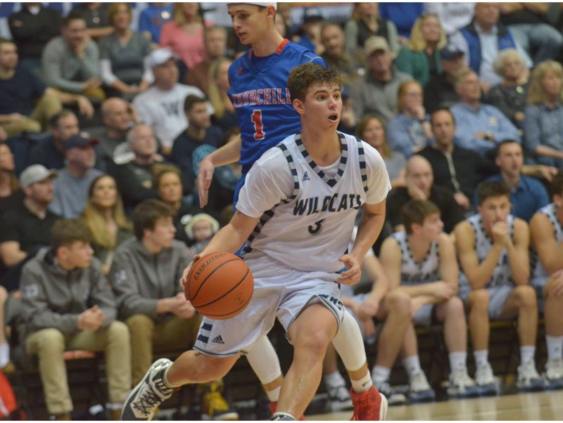 SPOKESMAN PHOTO: COREY BUCHANAN - Wilsonville sophomore guard Jack Roche had to dribble around the Churchill defense before being fouled late in the game.