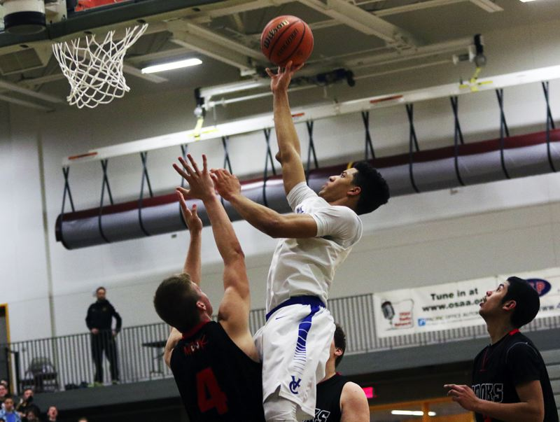 DAN BROOD - Valley Catholic senior Daniel Hardy goes up high for a shot during the Valiants' win over Tillamook.