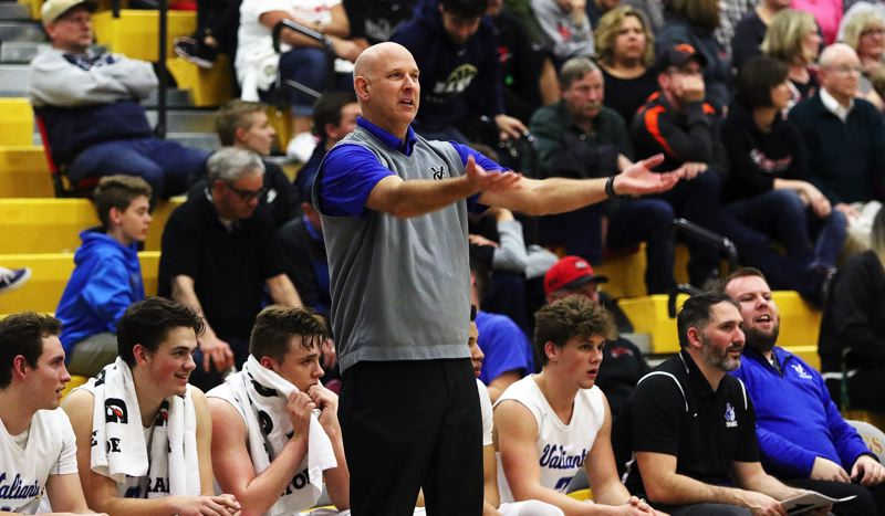 DAN BROOD - Valley Catholic head coach Joel Sobotka looks to fire up the Valiants crowd near the end of Friday's state playoff semifinal game.