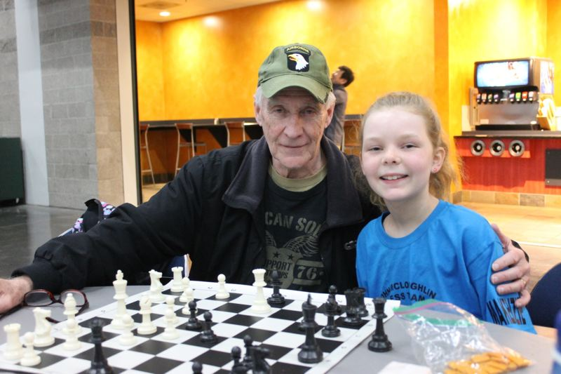 TRIBUNE PHOTO: LYNDSEY HEWITT - Makenzie DeVault, 11, a student at John McLoughlin Elementary School in Oregon City, attended the tournament with her grandfather, Mark Hagey.