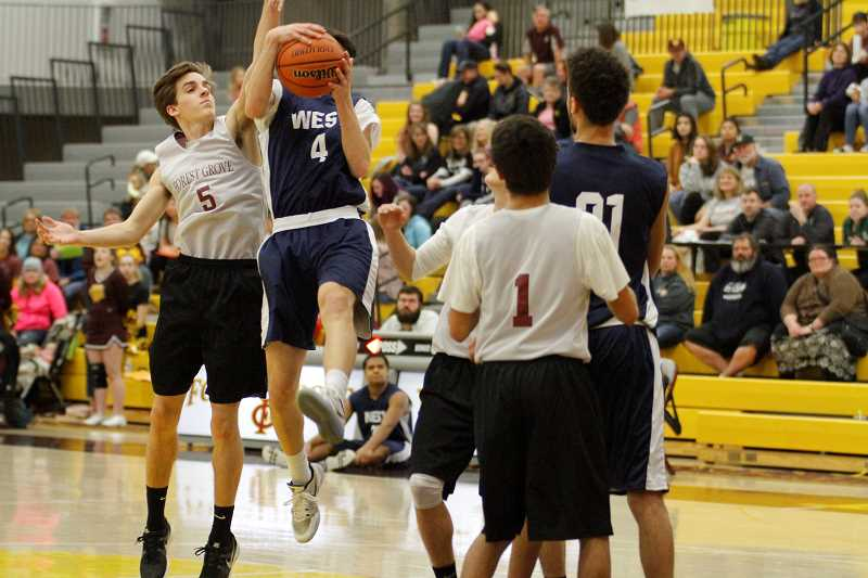 NEWS-TIMES PHOTO: WADE EVANSON - Forest Grove's Logan Hitchcock (5) goes up to block a shot while his teammate Juan Gomez Gutierrez (1) helps out.