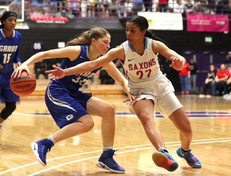 TRIBUNE PHOTO: JAIME VALDEZ - Grant High's Nina Radford evades South Salem standout Evina Westbrook during Saturday night's Class 6A third-place game in the girls basketball tournament at Chiles Center.
