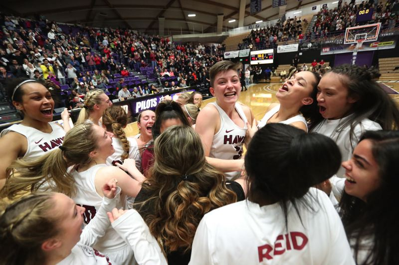 TIMES PHOTO: JAIME VALDEZ - Maggie Freeman and the Southridge girls basketball team celebrate their Class 6A state championship win over Oregon City.
