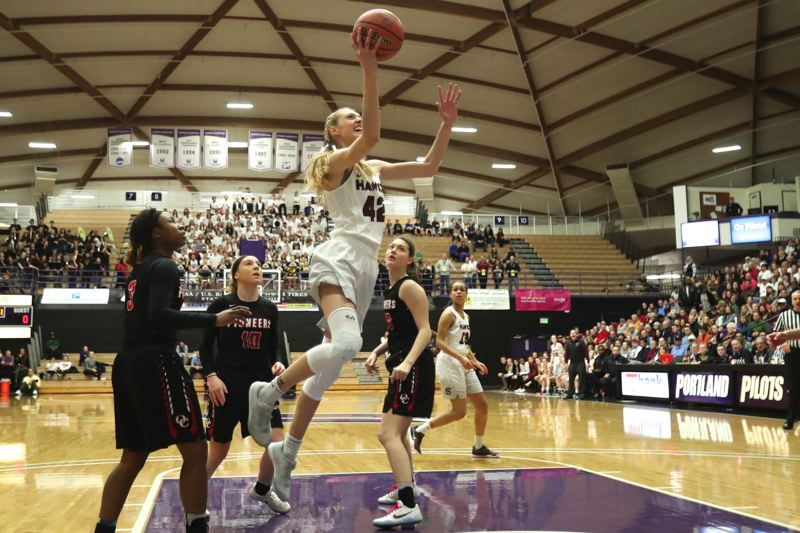 TIMES PHOTO: JAIME VALDEZ - Southridge freshman Cameron Brink makes her way to the basket against Oregon City.