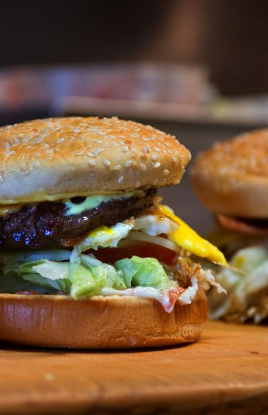 PAMPLIN MEDIA GROUP: JOHN M. VINCENT - Among the reasons for the success of Stanich's burgers are the fresh ingredients that they use, including hand-cut veggies. Of course, the bacon, ham, and egg on the burgers play a part as well. After all, they're burgers, not health food.