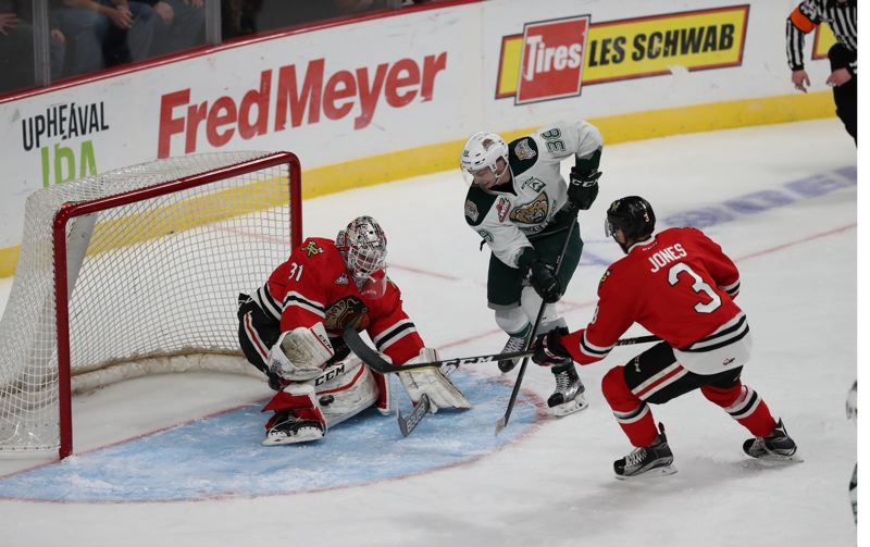 COURTESY: AL SERMENO/PORTLAND WINTERHAWKS - Portland Winterhawks goaltender Cole Kehler makes a pad save on a shot by Everett defenseman Kevin Davis on Sunday at Moda Center.