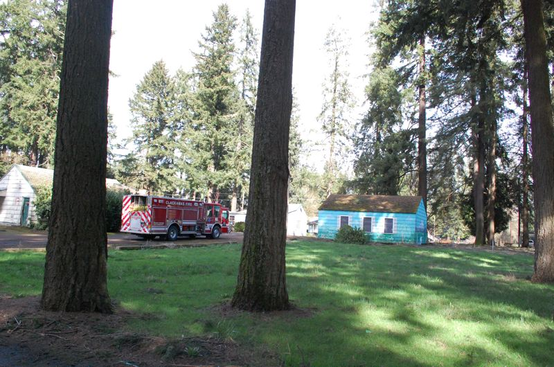 PHOTO BY: RAYMOND RENDLEMAN - Clackamas Fire took part in a regional training exercise at the former evangelical campground in Jennings Lodge. The buildings there have been used as a training ground lately due to the property owners expectation that the buildings and trees will be razed to make way for a 72-lot subdivision.