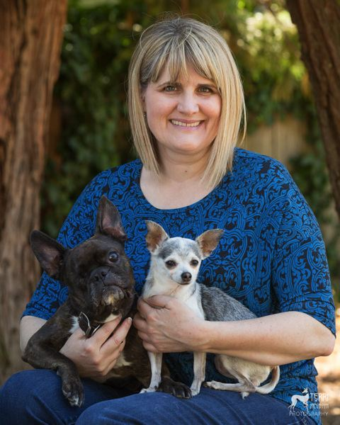 PHOTO BY TERRI JACOBSON - Dr. Lori Braun, a mobile veterinarian with Lap of Love, poses with Gizmo, her 8-year-old French bulldog, and Noodle, her 11-year-old Chihuahua.