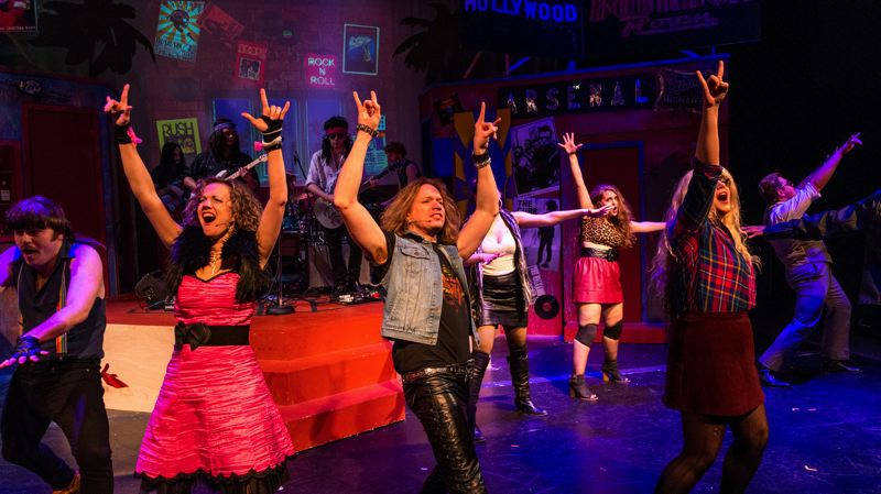 COURTESY: STUMPTOWN STAGES - Jon Conver (middle) feels good every night he gets to play Drew in 'Rock of Ages' for Stumptown Stages. 'I see a lot of myself in Drew,' he says. The show has been extended through March 19.