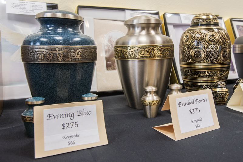 OUTLOOK PHOTO: JOSH KULLA - Urns for cremated remains on display at a recent event at MHCC. More than 70 percent of Oregonians are cremated.