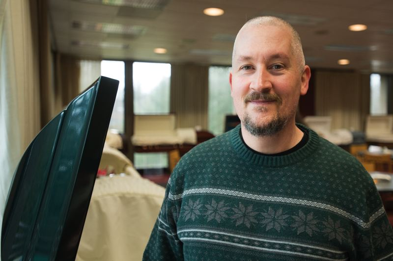 OUTLOOK PHOTO: JOSH KULLA - Doug Ferrin has directed the MHCC funeral services program for 13 years. The program, which costs about $16,000 a year, helps find jobs for most of its graduates.