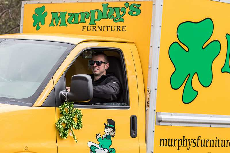 NEWS-TIMES PHOTOS: CHASE ALLGOOD - Murphy's Furniture of Cornelius is the longtime sponsor of the St. Patricks Day Parade and leads the way with its banner and truck.