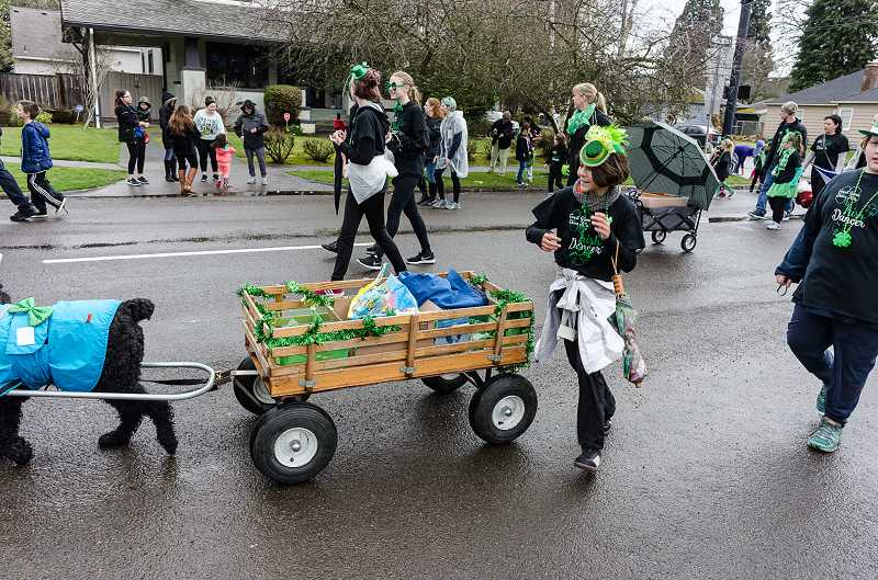 NEWS-TIMES PHOTO: CHASE ALLGOOD - Forest Grove Dance Arts sent a contingent of dancers -- and a wagon-pulling dog -- to liven up the parade.