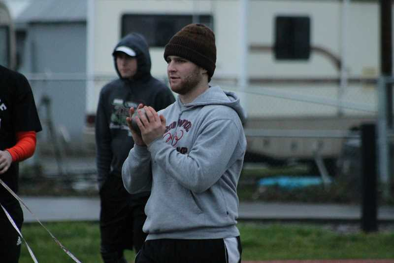 PIONEER PHOTO: CONNER WILLIAMS - Molalla senior Mont Child holds his shot put as he prepares for a throw during practice on March 9 at Heckard Field. Child is looking to defend his state title after coming off shoulder surgery last November.
