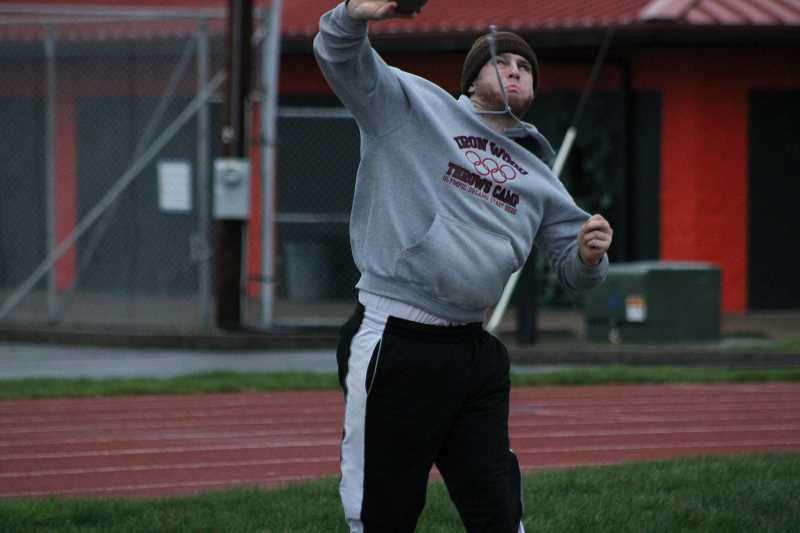 PIONEER PHOTO: CONNER WILLIAMS - Child launches a nearly 50-footer during practice on March 9 at Heckard Field. Even after surgery, he's