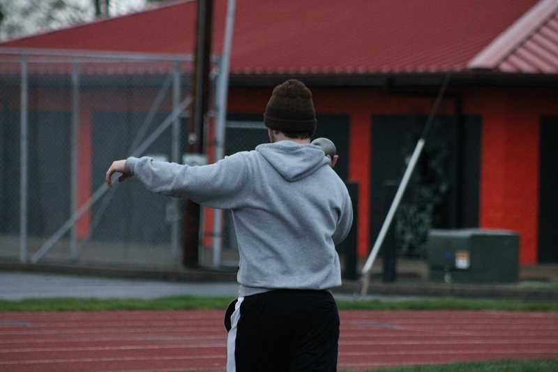 PIONEER PHOTO: CONNER WILLIAMS - Child readies for a throw.