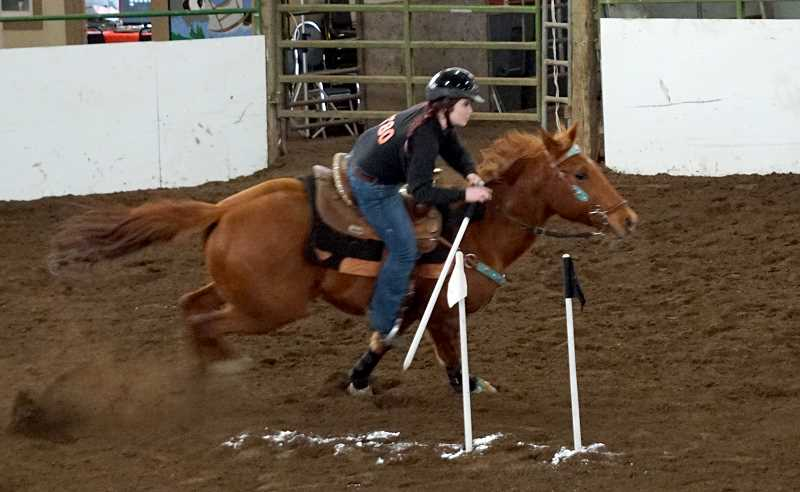 SUBMITTED PHOTO: AMY EDWARDS  - Molalla senior Codi Mae Edwards competes in the Canadian Team Flag Race to help her team grab first place with a time of 39.61 at the first Tri-River Valley OHSET meet at the Yamhill County Fairgrounds on Feb. 16-19.