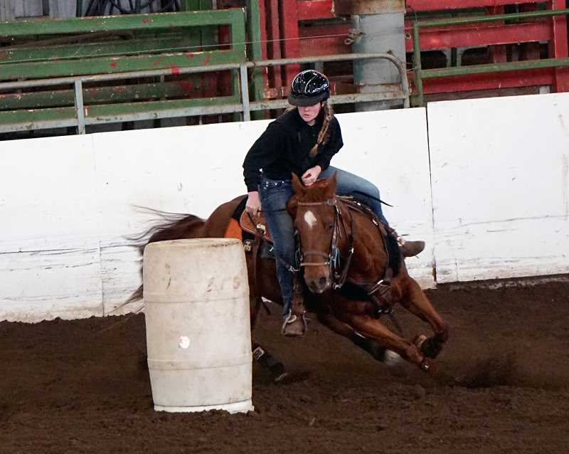 SUBMITTED PHOTO: AMY EDWARDS  - Molalla senior Shawnee Gibbons competes in the Barrels at the first Tri-River Valley OHSET meet at the Yamhill County Fairgrounds on Feb. 16-19. Gibbons took second in the event.