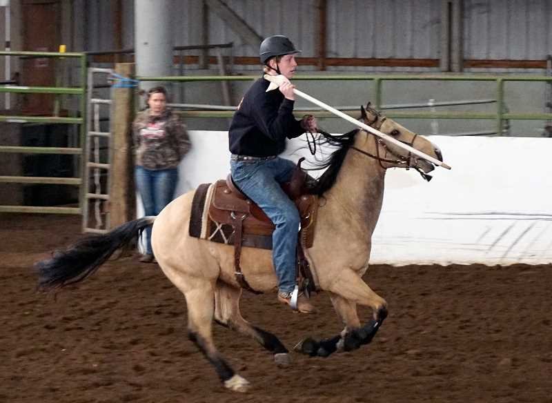 SUBMITTED PHOTO: AMY EDWARDS  - Molalla senior Garrett Veltman competes in the Individual Flags at the first Tri-River Valley OHSET meet at the Yamhill County Fairgrounds on Feb. 16-19. Veltman took third in the event.