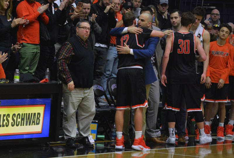 TIMES PHOTO: MATT SINGLEDECKER - Beaverton senior Hunter Sweet and head coach Andrew Vancil share a final embrace in the final moments of the Class 6A third place game on Saturday.