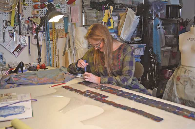 NEWS-TIMES/HILLSBORO TRIBUNE PHOTO: KATHY FULLER - While nursing two broken wrists from a bike accident, Paula Smith Danell has found other artistic pursuits that don't involve sewing.