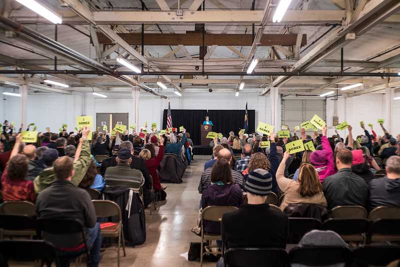 PMG PHOTO: CHASE ALLGOOD - Constituents packed the Washington County Fair Complex in Hillsboro Monday for U.S. Rep. Suzanne Bonamici's town hall.