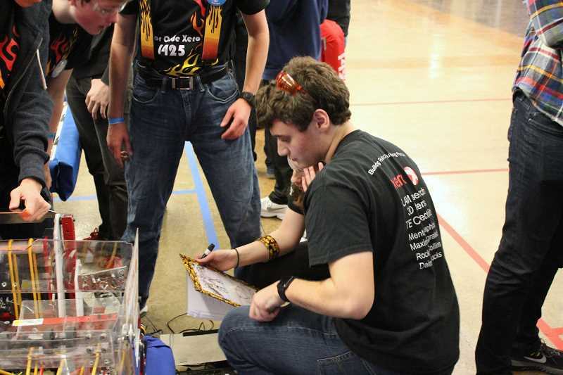SPOKESMAN PHOTO: ANDREW KILSTROM - Andrew Kassab and Sami Edwards work on strategy in between rounds March 10.