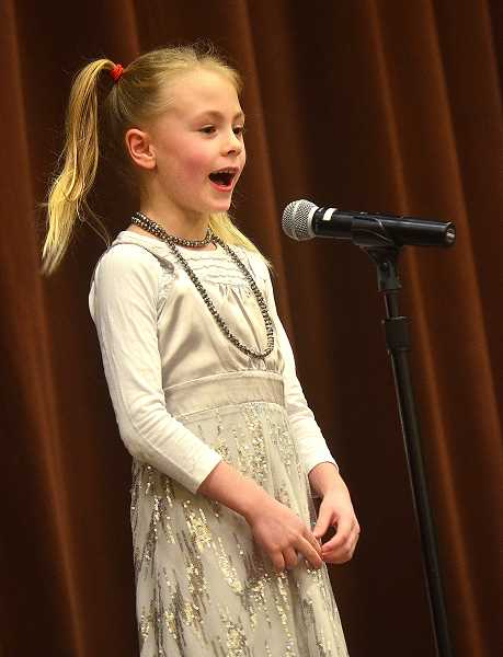 SPOKESMAN PHOTOS: VERN UYETAKE - First-grader Kelsi Shivers sings a song during Thursdays talent show.
