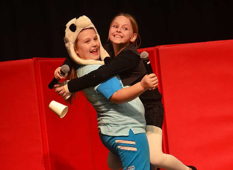 SPOKESMAN PHOTO: ANDREW KILSTROM - Lindsey Luper, left, and Sydney Cederberg embrace in a big hug after performing in the Lowrie Primary talent show.