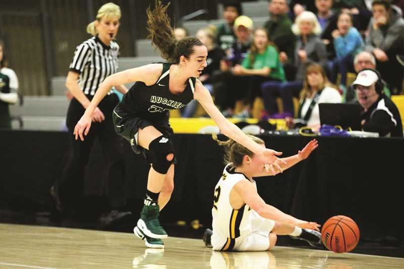 JO WHEAT - Emily Scanlan goes for a steal in the Huskies' sixth-place game against the Cascade Cougars on Saturday.